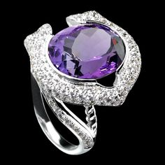 This is the kind of cocktail ring I am talking about. Big and Bold with an amazing Amethyst stone from CHARRIOL called SIGNATURA