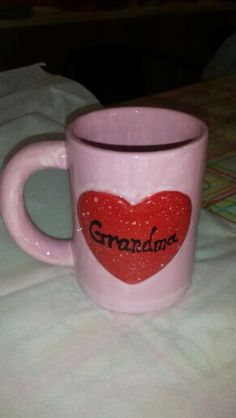 Grandma mug with my son's handprint on back. Painted at The Painted Turtle Pottery Studio