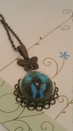 Glass Dome Mini Terrarium with Flowers, Moss and Butterfly Necklace, Teal Blue by FairyTalesNest on Etsy