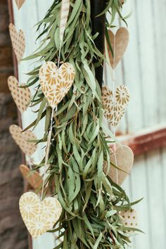 Hearts and garland: http://www.stylemepretty.com/2014/08/18/diy-gold-heart-arrows-rustic-whimsical-wedding-inspiration/ | Photography: Studio Finch - http://www.studiofinch.com/