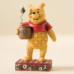 """Heartwood Creek by Jim Shore Disney Traditions  Winnie the Pooh: """"Silly Old Bear""""  Specifications   Height : 4.5 inches tall.  Materials : Stone Resin.    Your Price: $22.00"""