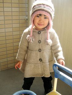Ravelry: haruhina's Tiered Coat ~ knit in 'Swish' bulky and sized from… Knit Baby Sweaters, Knitted Baby Clothes, Knitted Hats, Knitting For Kids, Baby Knitting Patterns, Crochet Baby, Knit Crochet, Baby Coat, How To Purl Knit