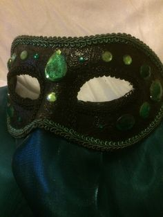Some of my newer silk-veiled Masquerade Venetian Masks that I made. Plastic jewels, glued onto painted mask chassis with silk scarves, cut and sewn onto the base.The lighting could be better but more photos will be taken later next week shown on some of my Aerial Silk.