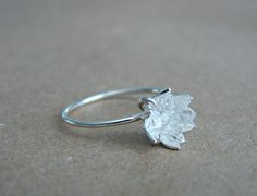 Raw Herkimer Diamond ring. Herks clustered together to form a blooming flower, my signature design. Voted #1 by Etsy shoppers! Some say it resembles a Lotus flower. The raw Herkimer Diamonds (also called a form of quartz crystal) are nestled together inside a leaf design cup and set into