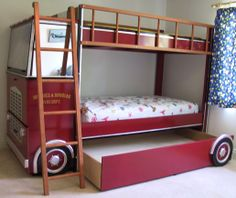 Custom made Fire Truck Bunk Bed I designed and built for a client. Has a trundle bed along with a desk that unfolds from the cab.