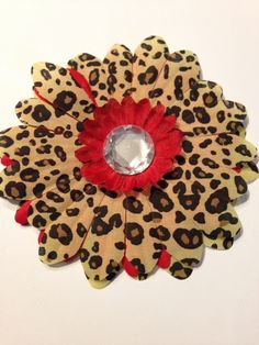 Flower Dog Collar  I.M. Cheetah Collection dog flower collar add on for your pet. Buy this bow for your pet and help a pet rescue organization at the same time.  Please visit, like and share our Facebook page under Isabella's Pet Shop.  Thank you.