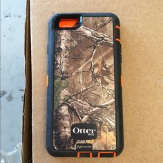 iPhone otter box 6/6s case Real tree camo with orange, nothing wrong with it, it's brand new fits iPhone 6 and 6s Outter box  Accessories Phone Cases