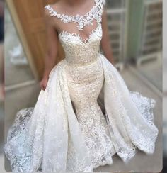 This pretty illusion neckline wedding dress has a pretty lace embellished over skirt. The fitted sheath wedding dress can be recreated with any design changes you need by our dress makers. We are in the US and offer all types of custom #weddingdresses to brides all over the globe. We also make #replicas of couture designs for less than the original for brides on a tighter budget. Email us for pricing. DariusCordell.com