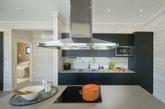 Black kitchen with steel appliances. Villa Merengue. Honka holiday homes.