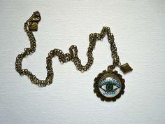 Eye Illustration Antique bronze pendant Using Winsor&Newton Cotman paper, watercolors and white stabilo carbothello