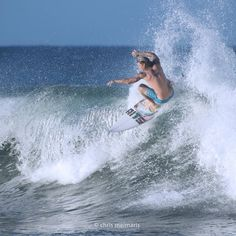 Toreador on a board at Snapper Rocks by chrismeimaris