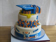 High School Graduation - 3 Tier Graduation cake for high school nephew.  Includes his love of Lacrosse and honors cords. Fondant decorations