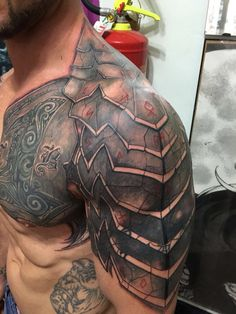 Awesome shoulder and chest tattoo