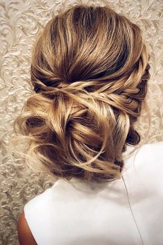 Braided updos are always in style. See our 11 step tutorial for a fun variation of braided updos.