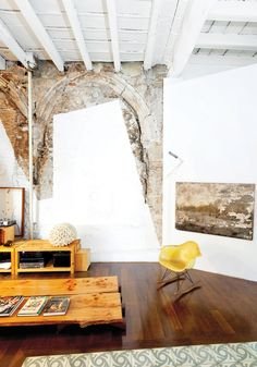 Immediately halting the crew, Tagliabue and Miralles decided instead to celebrate the juxtaposition by leaving it all in situ. The painting at right was also found inside the meandering structure, which had been unoccupied for decades.