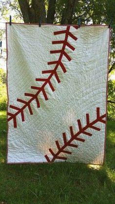 Whole cloth appliqué baseball quilt.: