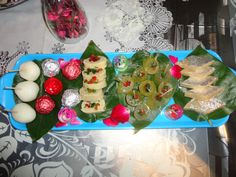 Decorated Sweet dish platter... with mouth watering Kaju katli, Anguri petha, kaju roles, chocolates and rasgullass....!!! yum.. try it...to impress your guests.. :)!!!