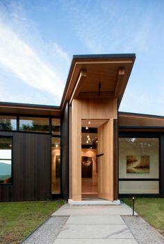緑に囲まれたナチュラルモダンな個人住宅 : The Arch Design
