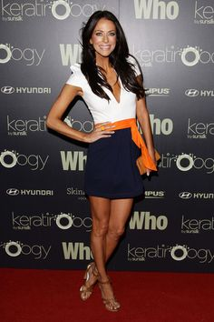 Really like the outfit! Really dislike the overkill on the spray tan and the 4 pounds of makeup.