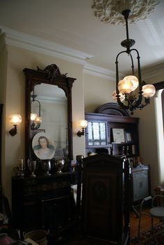 A place to see. In the center of the room is a 1870's 3-rod Mitchell Vance gas…