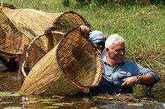 catching fish with wicker baskets in the Okavango Delta, Botswana.