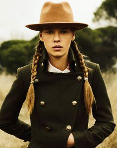 The hat, the coat, the braids.