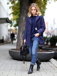 Annabel Rosendahl is wearing a blue coat from FWSS, sweater from Wild Wool, jeans from Current/Elliott, shoes from Alexander Wang and the bag is from Proenza Schouler