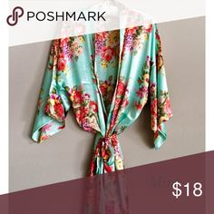 Mint Blue Floral Silky Satin Bridesmaids Robe New without tags! With a vintage floral pattern throughout, you and your bridesmaids are sure to feel elegant and in preparation for the big day. Soft to the touch, this kimono robe has a shine and flow to flatter all those who wear it. Designed with flowing elbow-length sleeves, you will be free to get ready without extra fabric hanging in your way. Features belt loops and a tie at waist. Perfect for a bridal or bridesmaids gift, bachelorette…