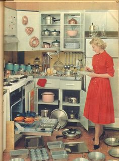theniftyfifties:  In the kitchen, 1950s. Hilarious! RevereWare, jello molds, house dress and all!