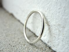 smooth slim sterling silver wedding band (in your size) by kimberlynogueira. $50.00, via Etsy.