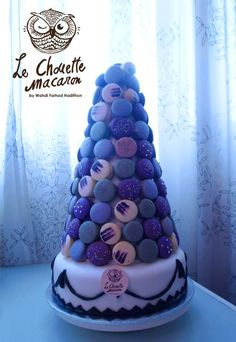 Super tall! My large size macaron tower; 130 pieces macaron on a 12-inch blueberry, butterscotch and yam cake.