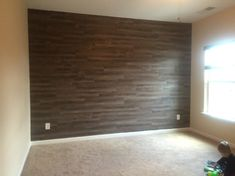 Vinyl Peel and Stick Hardwood for an accent wall in Baby Room.