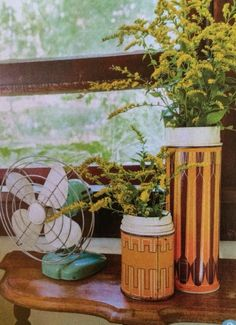 Vintage thermos used as flower vase for decor. Also love the wood shelf