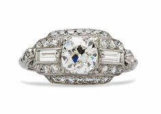 Millbrook is a vintage Art Deco diamond engagement ring featuring a 0.88ct Old Mine cut diamond accented on all sides by a frame of vintage diamonds. Click through to see a video! TrumpetandHorn.com | $7,850