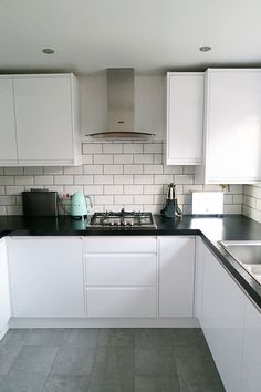 Our new kitchen which we designed with Wickes. I love the white gloss, mint SMEG accessories and subway tiles. White Gloss Kitchen, White Kitchen Cabinets, Kitchen Cabinet Design, Modern Kitchen Design, Kitchen Tiles, Kitchen Flooring, Diy Kitchen, Kitchen Decor, Kitchen Splashback Ideas