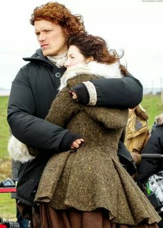 I LOVE, LOVE, LOVE THIS PIC OF SAM AND CAITRIONA - BUNDLED UP AGAINST THE SCOTTISH COLD - ON SET.