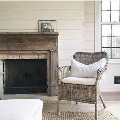 Shiplap wall in warm white with antique fireplace mantle - so much character and farmhouse feels. Farmhouse decor. Home decor ideas