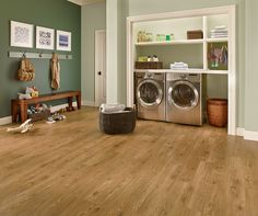 The water resistance of LVP makes it a great flooring choice for your laundry room!  |  Luxury Vinyl Plank  |  Laundry Room Makeover  |  Light & Water Resistant Flooring  |  Western Oak Golden Glaze Luxury Vinyl Plank  |  LVP  |  Laundry Room Ideas