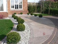 low maintenance landscape - and well draining driveway border: