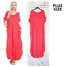 Loose fitting coral v-neck maxi with short sleeves and side pockets. Soft, comfortable jersey fabric. Hems are rounded in front and back, and there is a drop pleat on upper back.