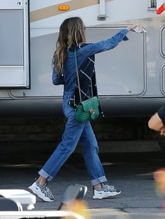 Cozy: She arrived on set wearing a comfortable retro-inspired denim jumpsuit worn with a n...