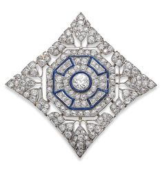 An Art Deco enamel and diamond plaque brooch.