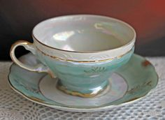 Porcelain Teacup & Saucer Set with Luster Green Finish and Hand Painted Floral Pattern.  Made in Japan.