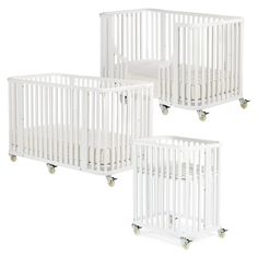 Layla Grayce Bassinet/Crib/Toddler Bed Combo.  This is really cool (and comes in dark wood also).