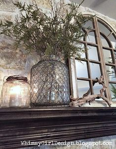 whimsy girl: Our Home: {Nature Inspired Spring Mantle} Oversized, wire covered jars with seasonal filler and driftwood pieces.