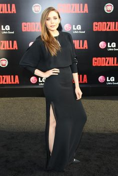 """While on the West Coast for her Los Angeles """"Godzilla"""" premiere, Elizabeth Olsen slayed with a sexy slit dress from Chloe's fall collection. [Photo by JB Lacroix/WireImage]"""