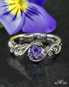 •Wrap Vine Lavender Sapphire Engagement Ring• A gorgeous lavender sapphire is caught in a twist of vine tendrils as two diamonds nestle among the leaves and curls.