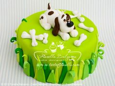 Dog cake.  Need to find a cream labradoodle topper.