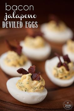 Bacon Jalapeño Deviled Eggs - A spicy two bite appetizer that people love, especially as game day grub or during a party.