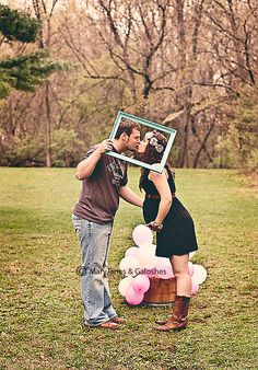 Couple shot during a maternity session.. often forgotten. Baby will love this of her parents. . She's still the focus. . But so is their love.